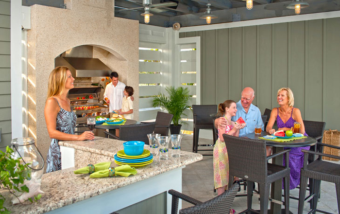 Outdoor dining area perfect for gathering the family near the pool (Mangrove Amenities Shown)